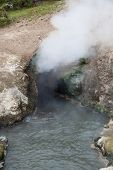 stock photo of hot water  - The cave opening of Dragon - JPG