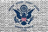 pic of coast guard  - flag of United States Coast Guard painted on brick wall - JPG