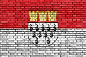 stock photo of koln  - flag of Cologne painted on brick wall - JPG