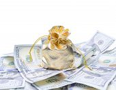 foto of sack dollar  - Gold sack and dollars on white background - JPG