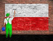 foto of flag pole  - House painter paints flag of Poland on old brick wall - JPG