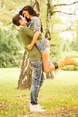 image of hot couple  - Embrace the young loving couple in the park - JPG