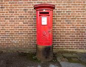 image of old post office  - Classic British red Post Office Box in a street in the UK - JPG