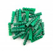 picture of butt plug  - Green plastic dowel pin pile isolated over white background - JPG