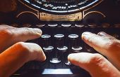 stock photo of typewriter  - Details of an old typewriting machine retro style with dusty metal and buttons - JPG