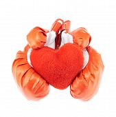 stock photo of boxing day  - Red and white boxing gloves holding the red plush toy heart - JPG
