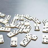 picture of over counter  - Multiple domino bones composition over the dark gray surface - JPG