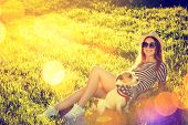 stock photo of hot dogs  - Happy Hipster Girl with her Dog Lying on the Grass - JPG