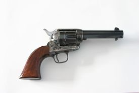 stock photo of colt  - Colt .45 Pistol, Peacemaker. Famous handgun of the American West. ** Note: Soft Focus at 100%, best at smaller sizes - JPG