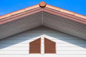 pic of gable-roof  - The roof gable with blue sky found in the suburb - JPG