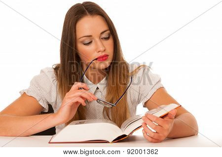 Happy asian caucasian girl reading thick book with glasses in hand isolated