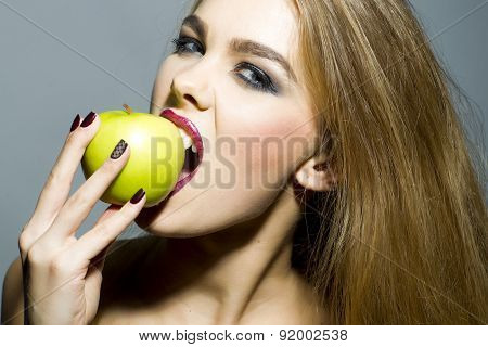Passionate Blonde Woman With Apple