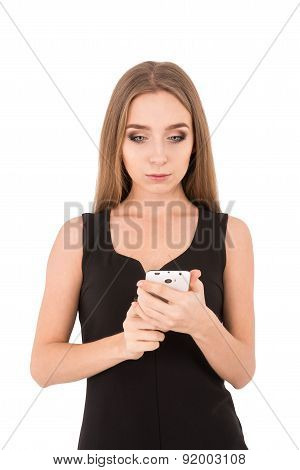 Girl In A Black Dress On A White Background. Girl Reads And Writes Sms