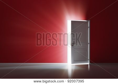 Rays of light through the open white door on red wall