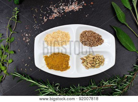 Aromatic Herbs And Spices Over Slate Sheet