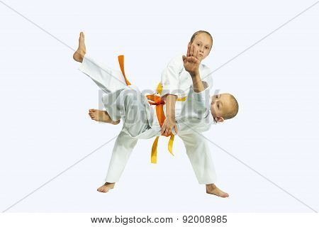Children athlete are training judo throws