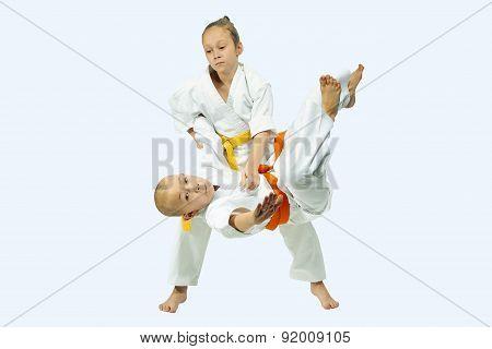 With yellow belt sportswoman is training throw