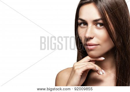 Portrait of a beautiful young woman on a white background