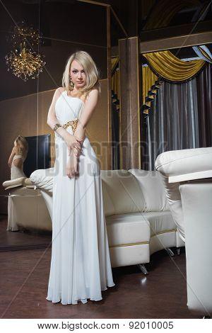 luxury girl in evening dress in beautiful settings