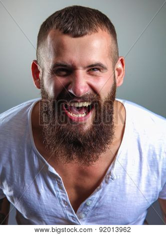 Portrait of handsome bearded man isolated on grey background.