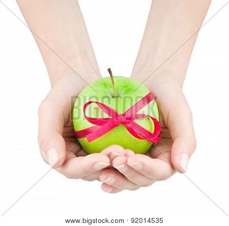 Apple With Ribbon In Women's Hands