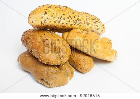 Assortment of baked goods on white background
