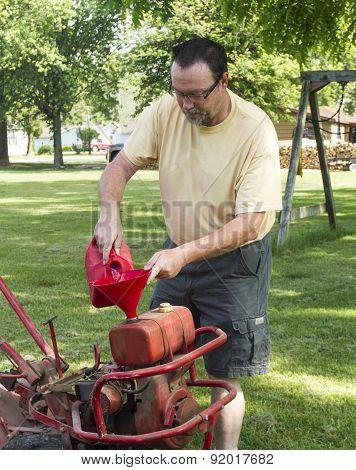 Putting Gas In A Old Garden Tiller