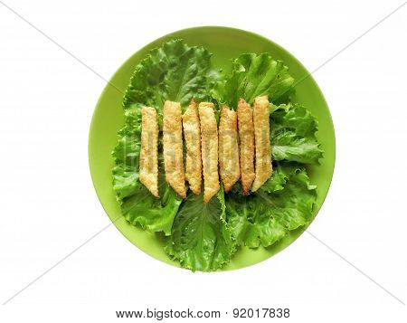 Curd salted sticks on lettuce leaves