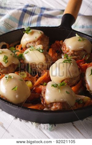 Meatballs Baked With Mozzarella Close-up In A Pan. Vertical