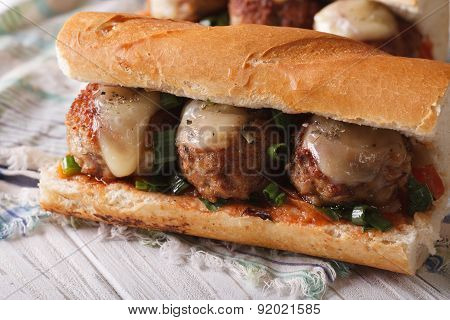 Tasty Sandwich With Meatballs And Sauce Close-up