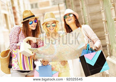 A picture of group of tourists using map in the city