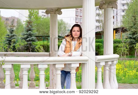 Pretty Young Woman In A Gazebo At The Park