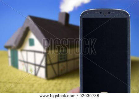 Smatrphone and house. Idea for smartphone home security system, monitoring system, real state applications, contractor, architecture, house improvements,  and others.