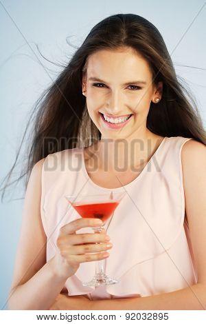 Young Woman Enjoying A Drink