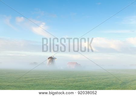 Beautiful Dutch Windmill In Morning Mist