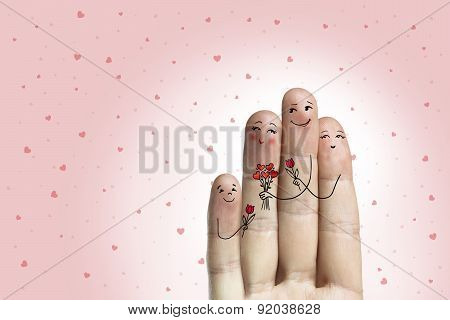 Conceptual Family Finger Art. Father, Son And Daughter Are Giving Flowers Their Mother.