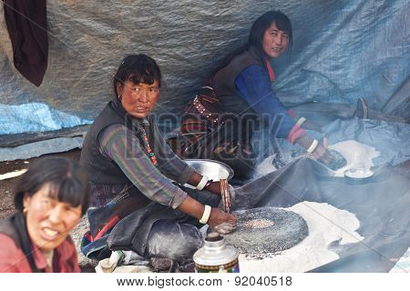 Tibetan women cooking in tent