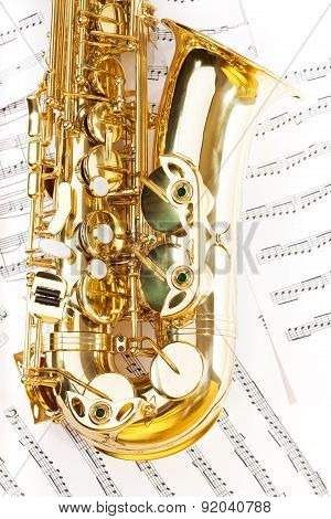 View of shiny golden alto saxophone bow part
