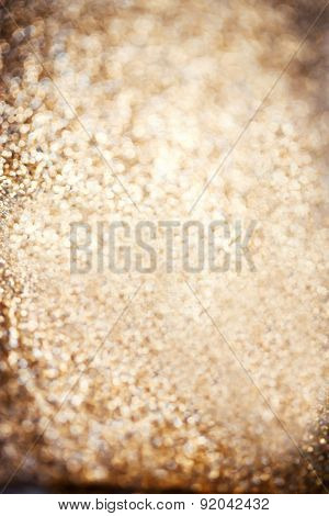 Christmas Background. Golden Festive Glowing Lights Abstract Glitter Defocused Background With Blink