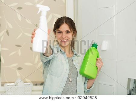 Beautiful Girl Cleaning Up Her House