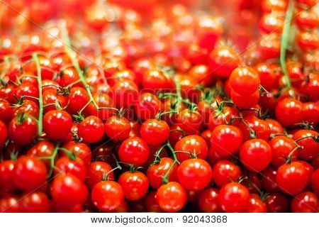 Background with fresh red tomatoes. Ripe cherry tomatoes in market