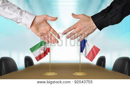 Iran and France diplomats agreeing on a deal