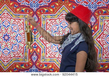 Happy Young Girl Looking At Lantern Celebrating Ramadan