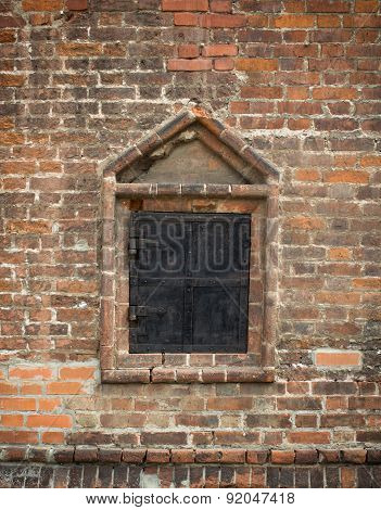 Old Window In A Brick Wall, Closed  Metal Shutters