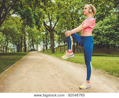 Woman doing stretching exercise before running