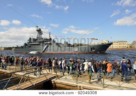 ST. PETERSBURG, RUSSIA - MAY 9, 2015: People look at the large landing craft Korolev during the naval parade dedicated to the WWII Victory Day
