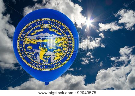 Balloon With Flag Of Nebraska On Sky