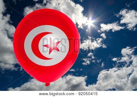 Balloon With Flag Of Tunisia On Sky