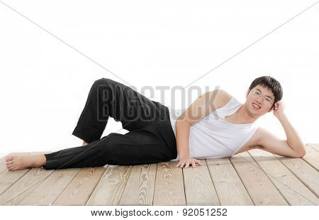 Portrait of happy smiling man lying on wooden floor , isolated