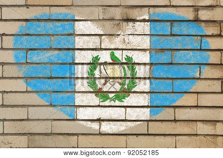 Heart Shape Flag Of Guatemala On Brick Wall